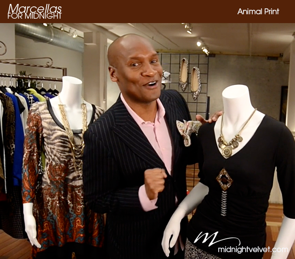 Marcellas Reynolds standing in front of animal print fashions from Midnight Velvet